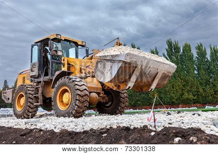 Samara, Russia - September 28, 2014: Heavy Bulldozer Loading And Moving Gravel On Road Construction