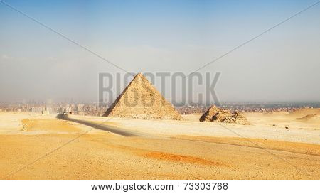 Panorama of Pyramids, Giza, with the sprawling modern city of Cairo in the background.