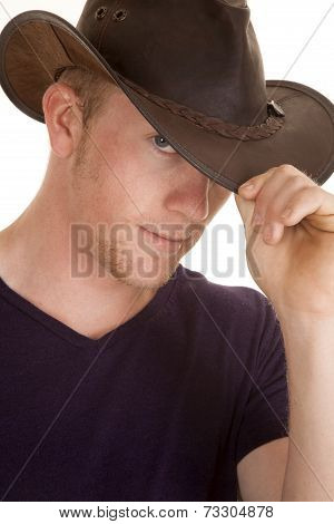 Man In Purple Shirt Hand On Cowboy Hat Close