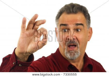 Man Holding Coins With Surprised Look On His Face