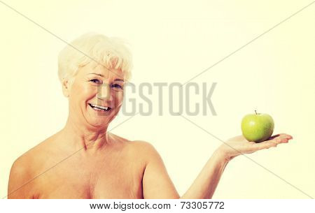 60 years old happy woman holding and apple