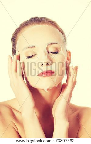 Beautiful caucasian woman with collagen mask. Isolated on white.