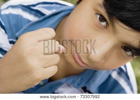 Hispanic boy making fist