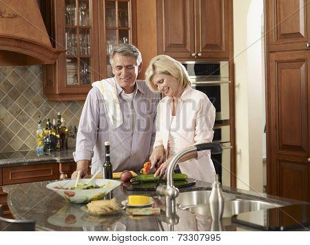 Multi-ethnic couple preparing food