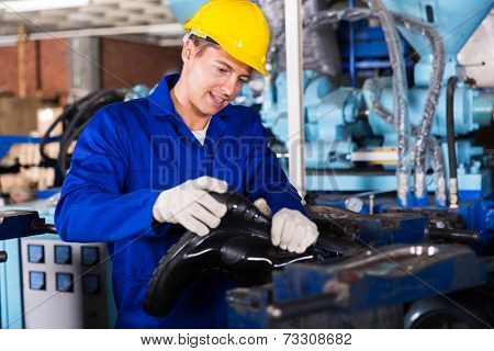 skilled man working in a gumboot factory