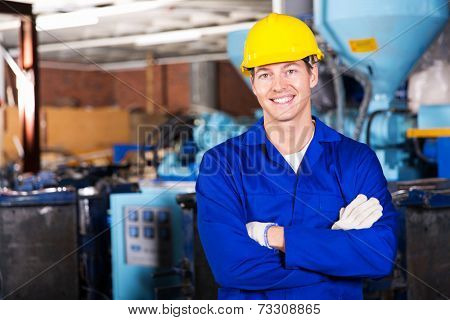 good looking blue collar worker in factory