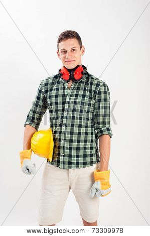 Workman wearing a yellow hard hat and full protective gear