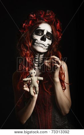 Young Woman With Calavera Makeup (sugar Skull) Piercing Voodoo Doll