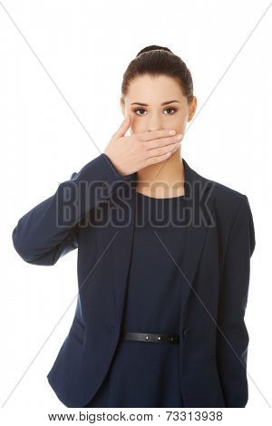 Portrait of young businesswoman covering with hand her mouth