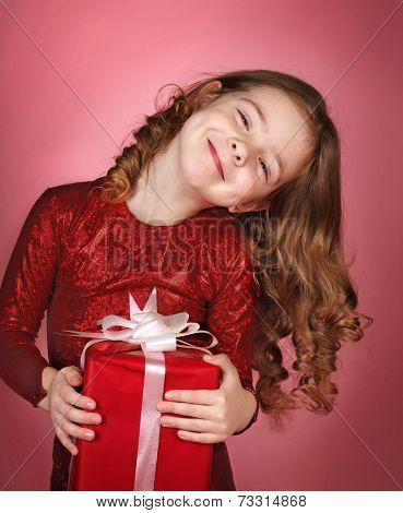 Happy little girl with christmas gift box