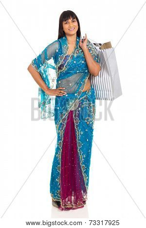 indian woman in saree carrying shopping bags on white background