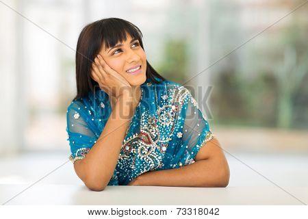 beautiful asian woman in sari looking up