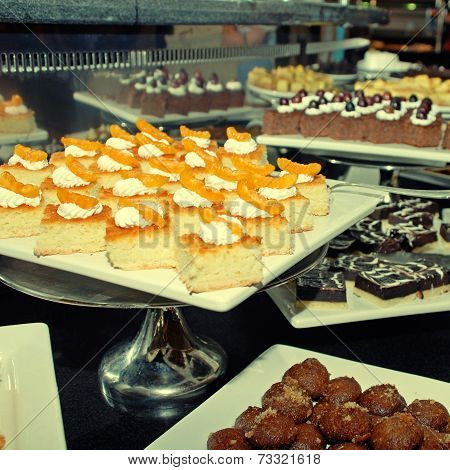 Dessert Bar With Assorted Fruit And Chocolate Sweets.