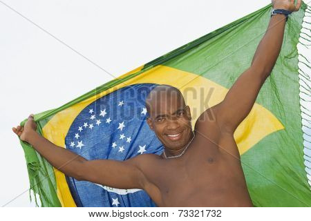 African man holding up beach wrap