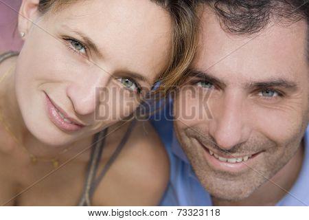 Hispanic couple touching heads