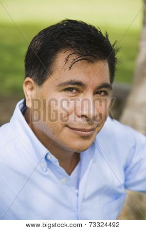 Close up of Hispanic man smiling