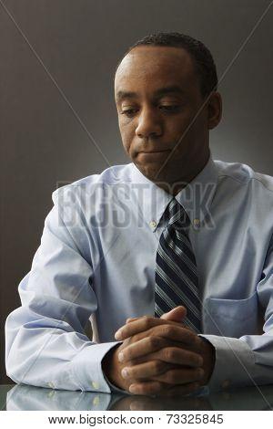 Sad African businessman