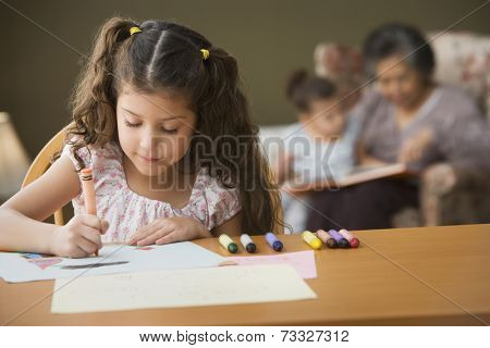Young girl coloring at table