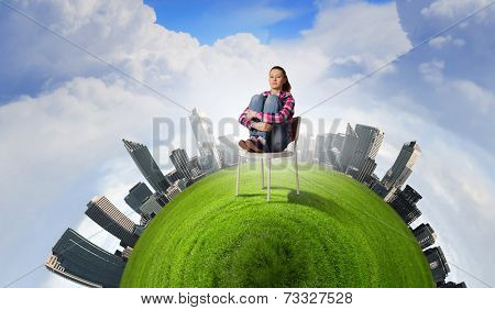 Young troubled woman sitting in chair on green planet
