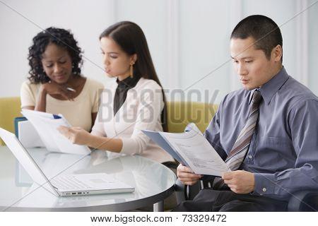 Asian businessman reading paperwork