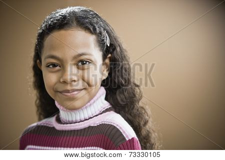 Mixed Race girl with barrette in hair