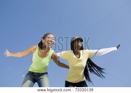 African women with arms outstretched