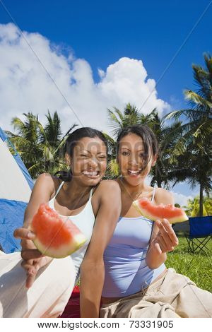 Hispanic women eating watermelon