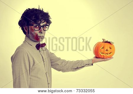 a hipster zombie with a jack-o-lantern in his hand, like Hamlet, with a retro effect