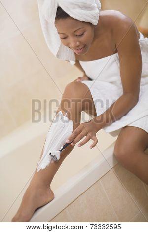 African woman shaving legs