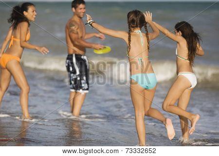 Hispanic family playing at beach