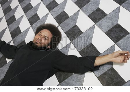 Mixed Race man laying on floor