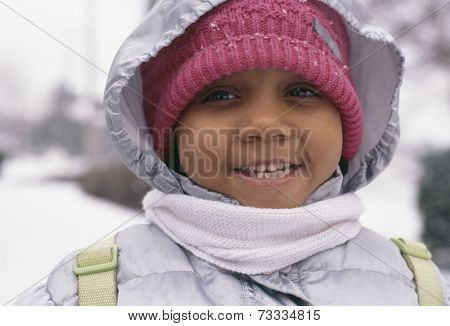 African girl in winter clothing