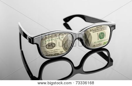 Black glasses with dollars instead of lenses