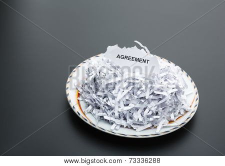 Heap of white shredded papers on the plate