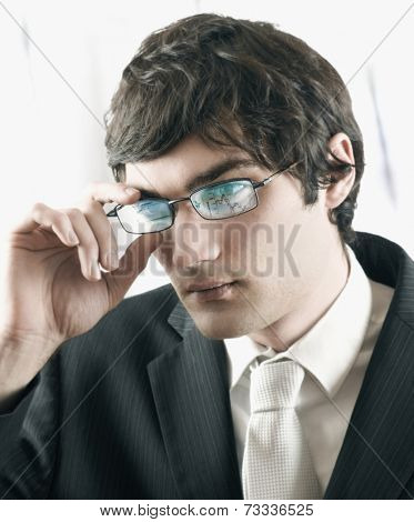 European businessman with reflection on eyeglasses