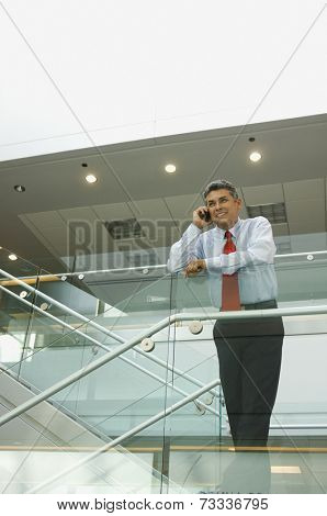 Hispanic businessman talking on cell phone