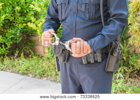 Policeman Holding Handcuffs