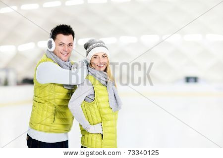 A picture of a happy couple in the ice rink