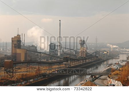 Old, dirty industrial district with smog