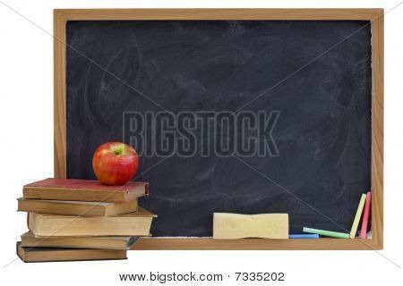 Blackboard With Old Textbooks And Apple