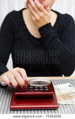 Woman Watching Sum On Calculator With Magnifying Glass And Cant Believe Numbers On It