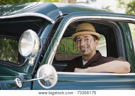 Hispanic man sitting in truck