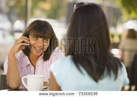 African teenaged girl talking on cell phone