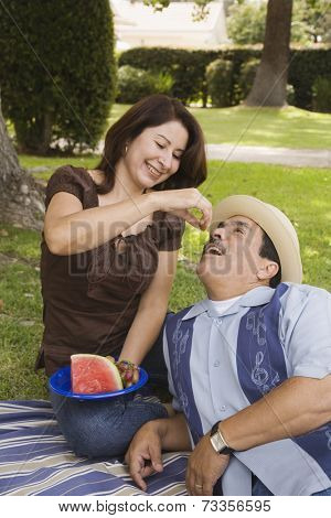 Hispanic couple having picnic