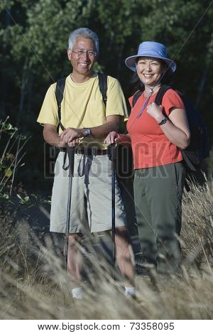 Asian couple hiking