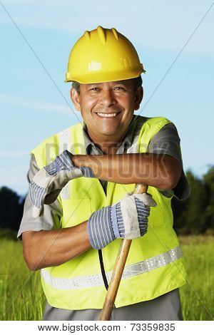 Hispanic man wearing hard hat and reflective vest