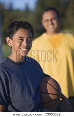 Hispanic boy holding basketball