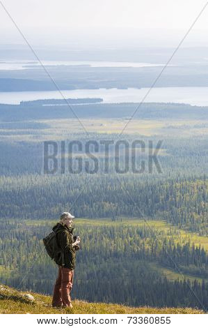 woman on a top of hill