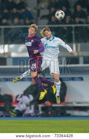 VIENNA, AUSTRIA - DEZEMBER 11 Cristian Ansaldi (#3 Zenit) and Daniel Royer (#28 Austria) fight for the ball at a UEFA Champions League game on Dezember 11, 2013 in Vienna, Austria.