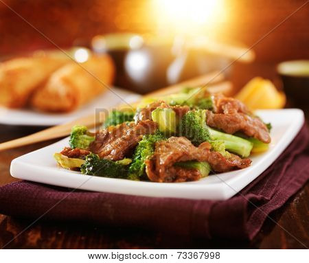chinese beef and broccoli  stir fry in warm light